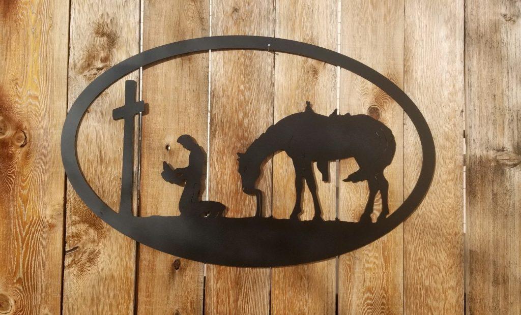 praying cowboy sign
